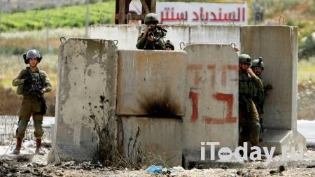 Израильский охранник открыл огонь по палестинке с ножом